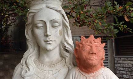 Baby Jesus statue's head returned after orange replacement becomes viral joke